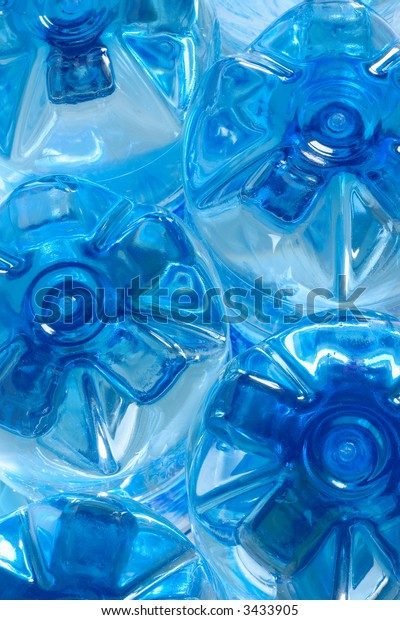 Blue plastic bottles with spring water, bottom view