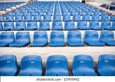 Blue plastic chair in stadium