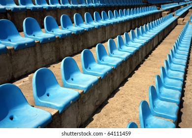 blue plastic empty seats on football stadium