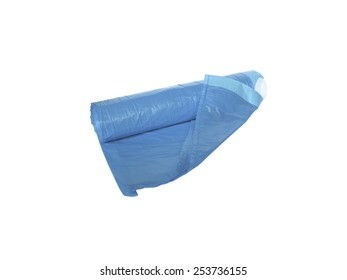 Blue plastic garbage bags, rolled up in a roll with a tilted angle. New, not used.