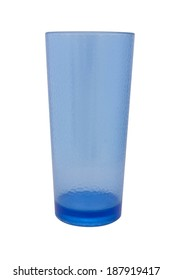 Blue plastic glass for juice, isolated on white background.