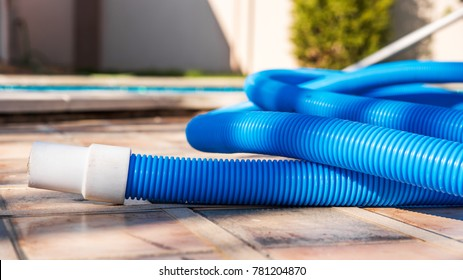 Blue plastic hose for cleaning a swimming pool,  Close-up
