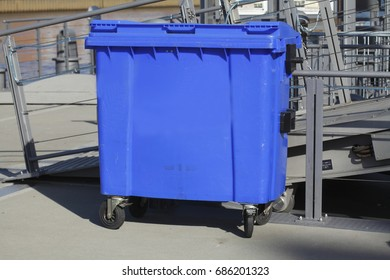 blue plastic recycling bin for waste paper