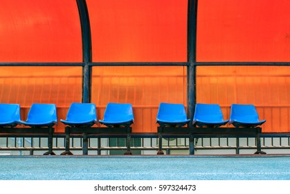 The blue plastic seats for substitute football player and staff coach in sport stadium.