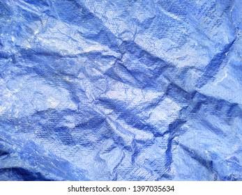 Blue plastic tarp abstract horizontal background texture