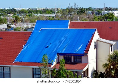 Blue plastic tarpaulin temporarily covers roof damage caused by Hurricane Irma.