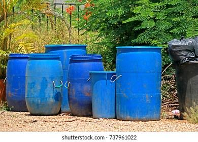 Blue plastic trashcan