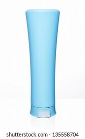 Blue plastic tube cream bottle