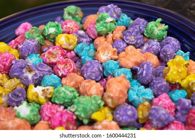 blue plate with bright multi colored popcorn