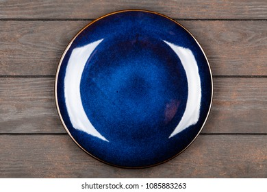 Blue plate on brown wooden table