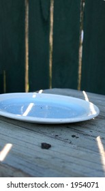 Blue plate on table