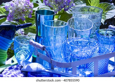 Blue plates, glasses, and bowls for a summer party