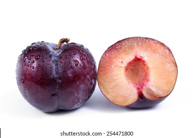 Blue plum and a half of a plum