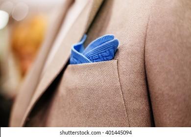 Blue pocket square in a jacket pocket