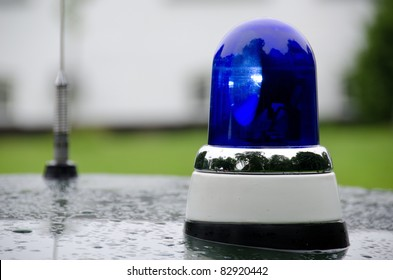 blue police light shining on an old police car in Denmark