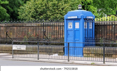 A blue police telephone box on the street in Glasgow, Scotland, United Kingdom, often associated with the science fiction television program Doctor Who