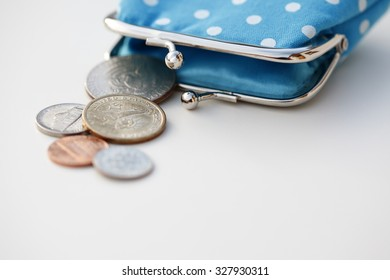Blue polka dot purse with coins