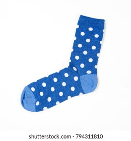 the blue polka dotted socks on white background