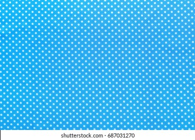 Blue polka-dot cotton table cloth.