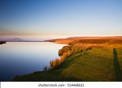 Blue pond last night of day. Keepers Pond, The Blorenge, Abergavenny, Wales, United Kingdom