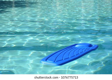 Blue pool float in refreshing cool blue swimming pool.