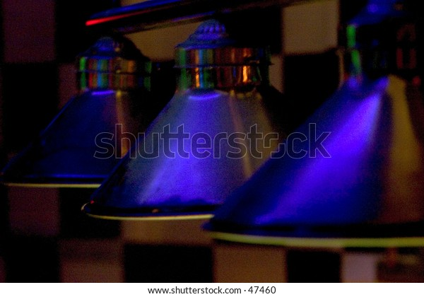 blue pool table lights in a dark room