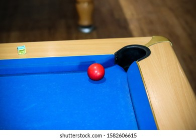 Blue Pool Table and Red Ball
