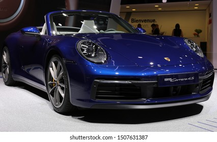 Blue Porsche 911 Carrera 4S Cabriolet in Geneva International Motor Show (GIMS), Geneva Switzerland March 2019. Iconic 911 had it's world premiere as a cabriolet in GIMS 2019. 450 hp. Color image.