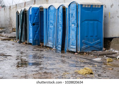 blue portable toilets on the construction site