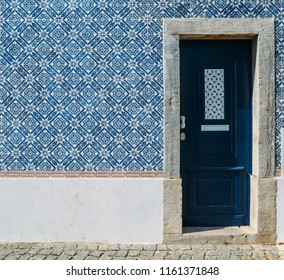Blue Portuguese style azulejo tiles and door, captured in Cascais, Portugal.