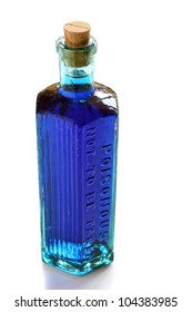 Blue potion in a vintage poison bottle. On white