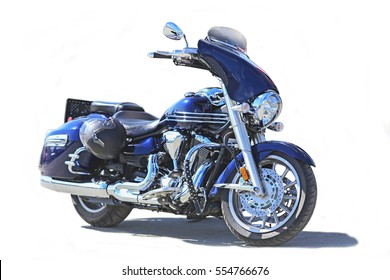 Blue powerful motorcycle on white background