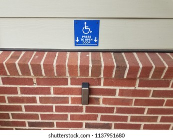 blue press to open wheelchair button and red bricks
