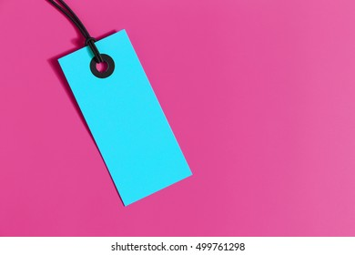 Blue price tag on pink background