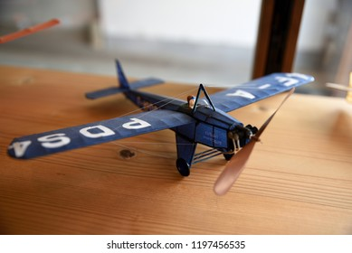 A blue pro-hela airplane made of Japanese paper