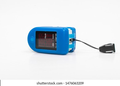 blue pulse oximeter on isolated white background