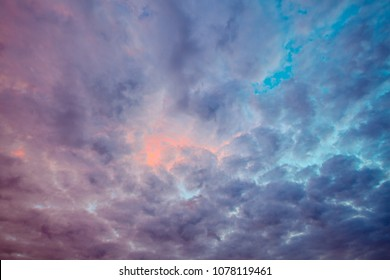 Blue and purple clouds colored by beautiful sunset