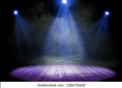 Blue purple lighting and smoke on stage with floor wood
