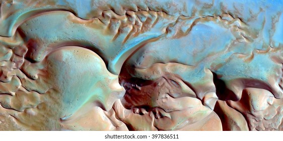 blue puzzle on the dunes, abstract composition of dune landscape, abstract photography of the deserts of Africa from the air, bird's eye view, abstract expressionism,contemporary art, optical illusion