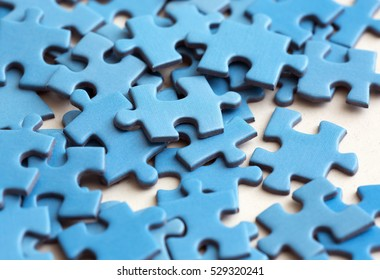 Blue puzzle pieces on a white surface.