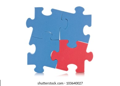 blue puzzle sign with one red piece
