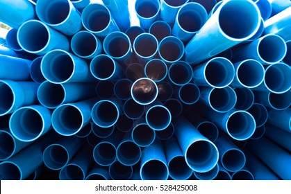 Blue PVC tubes in storage, Plastic tubes, Background of PVC