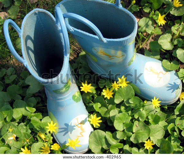 Blue rain boots and yellow flowers.