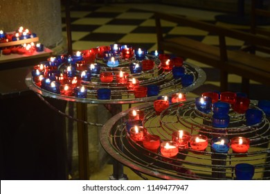 Blue and red candles in the Norte Dame Church, Paris