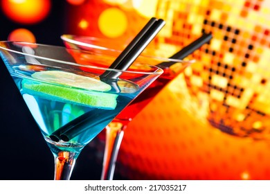blue and red cocktail with sparkling disco ball background with space for text, dance disco concept