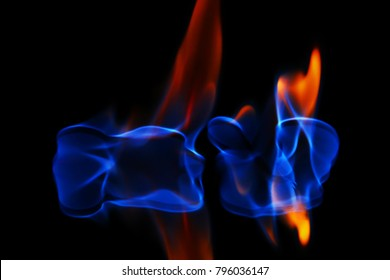 blue and red fire on a black background.