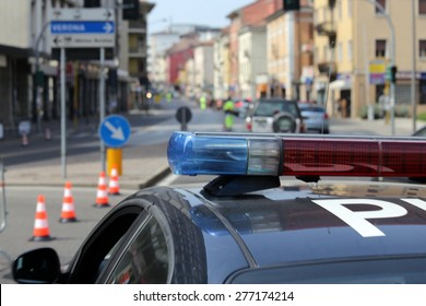 Blue and red flashing sirens of police car during the roadblock in the city