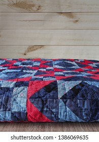 Blue and Red Folded Patchwork Quilt with Hand Quilting