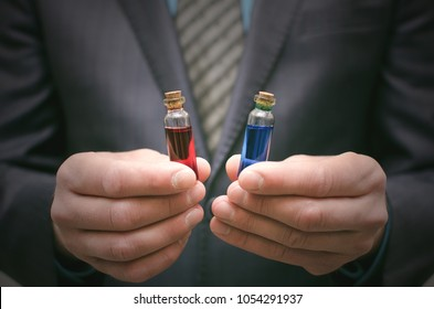 Blue and red pill essential liquid in business man hands. Choosing of right pill. Steroid or drug presentation. Medication for all diseases concept. Pharmacological or pharmaceutical business.