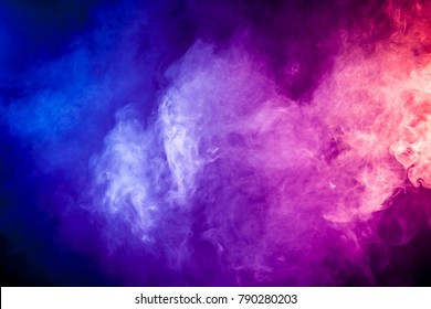 Blue, red, pink abstract cloud of smoke pattern on a black isolated background